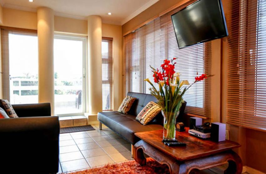 Secret garden strelitza luxury apartment in bloubergstrand My secret garden bay city